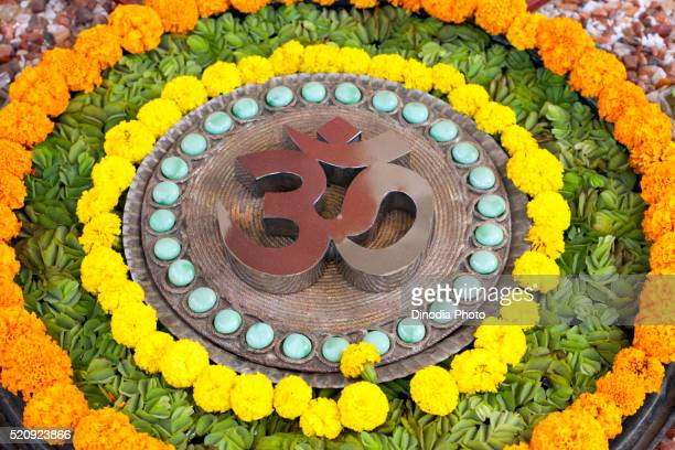 Om design pebbles flowers concentric circle, India, Asia