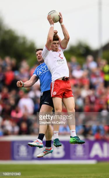Omagh Ireland 21 July 2018 Cathal McShane of Tyrone in action against Philly McMahon of Dublin during the GAA Football AllIreland Senior Championship...