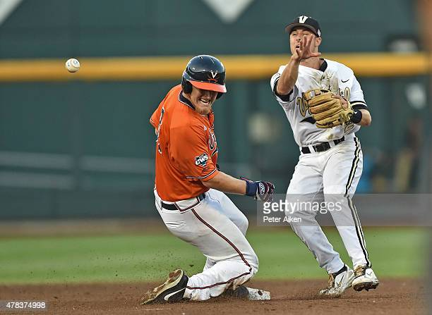 Omaha NE JUNE 24 Second basemen Tyler Campbell of the Vanderbilt Commodores makes a throw to fist after forcing out base runner Joe McCarthy of the...