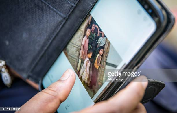 Omal Khair looks through photos on her phone on October 28, 2019 in Cox's Bazar, Bangladesh.Omal Khair is a media fellow with Doha Debates and...