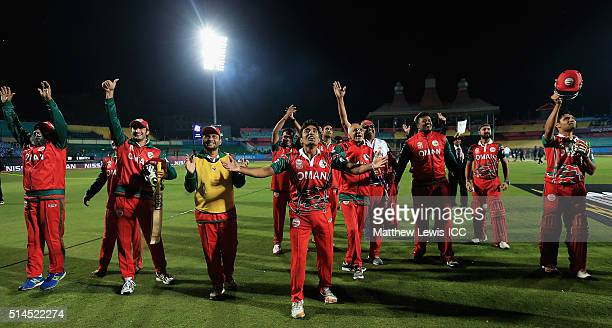 Oman celebrate their victory over Ireland during the ICC Twenty20 World Cup match between Ireland and Oman at the HPCA Stadium on March 9 2016 in...