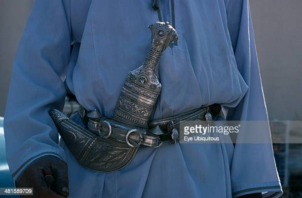 Oman General Detail of traditional silver curved dagger or khanjar worn at the waist by Omani men