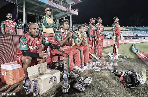 Oman look on from the dugout before their over Ireland during the ICC Twenty20 World Cup match between Ireland and Oman at the HPCA Stadium on March...