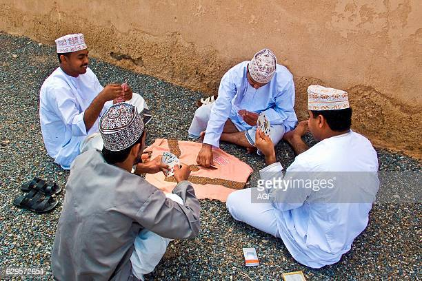 Oman Men Playing Cards In Jabrin Fort