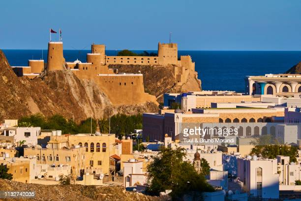 oman, muscat, mirani fort and al alam palace of sultan qaboos - image stock pictures, royalty-free photos & images