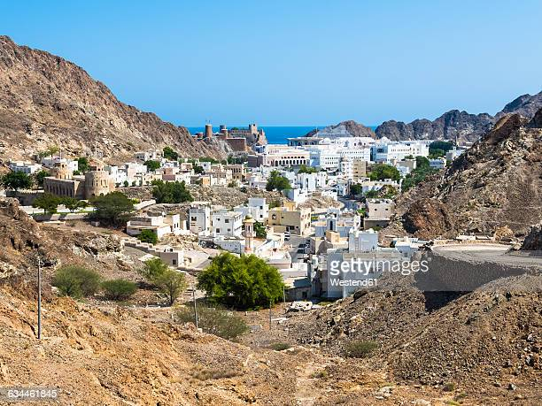 oman, muscat, old town, fort mirani and fort al-mirani - muscat governorate stock pictures, royalty-free photos & images
