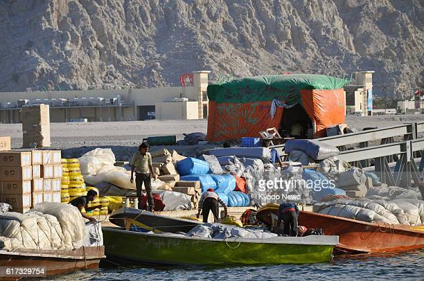 KHASAB Oman People load goods onto a boat at a port in Khasab northern Oman for smuggling into Iran via the Strait of Hormuz on Jan 16 2012