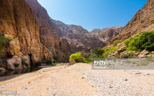 Oman, People walking in Wadi Tiwi