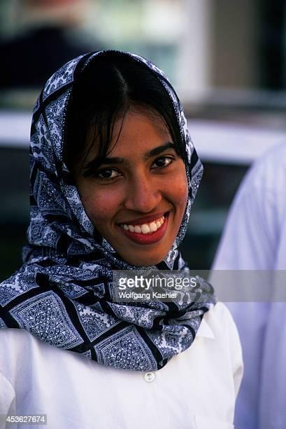 Oman Salalah Street Scene Portrait Of Young Woman