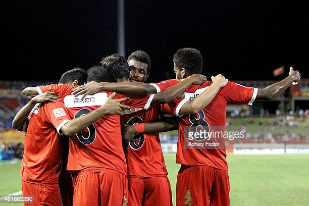 Oman team mates celebrate a goal during the 2015 Asian Cup match between Oman and Kuwait at Hunter Stadium on January 17 2015 in Newcastle Australia