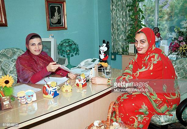 Omani businesswoman Areej Mohsin Darwish and her sister Lujiana a parliament member pose for a photograph in Muscat 20 September 2000 A new breed of...