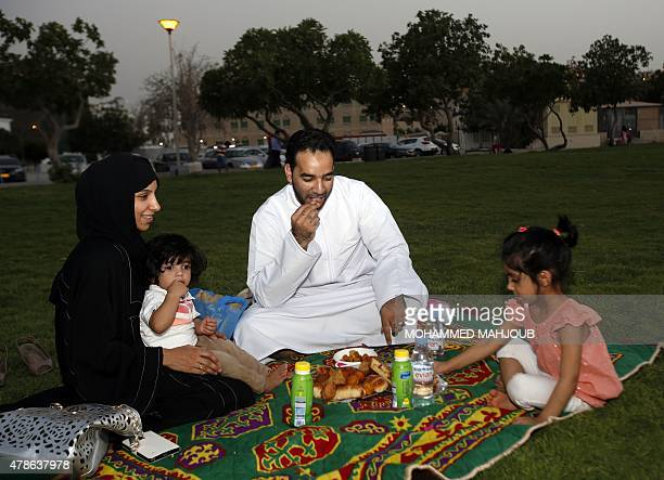 A Omani family gathers to break their fast in the holy month of Ramadan on the beach in Muscat on June 26 2015 Across the Muslim world the faithful...