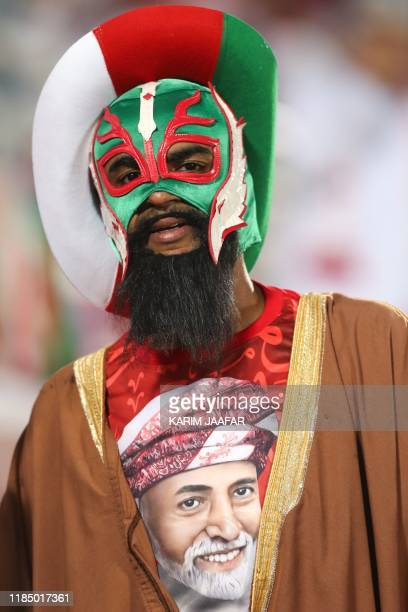 A Omani fan wearing a shirt bearing the portrait of Oman's Sultan Qaboos during the 24th Arabian Gulf Cup Group B football match between Oman and...