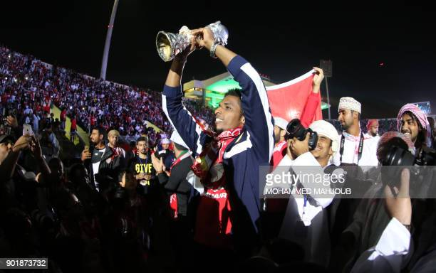 Omani fans and players attend a celebration ceremony to welcome Oman's national football team after they won the 23th Gulf Cup of Nations, in Muscat...