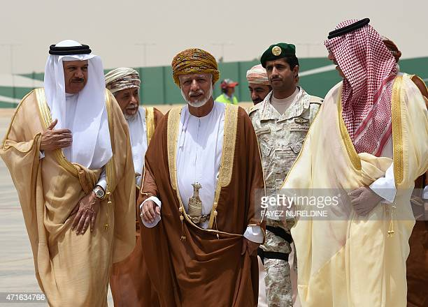 Omani Foreign Minister Yussef bin Alawi bin Abdullah is ecorted by Saudi deputy minister of Foreign Affairs Abdulaziz bin Abdullah and Secretary...