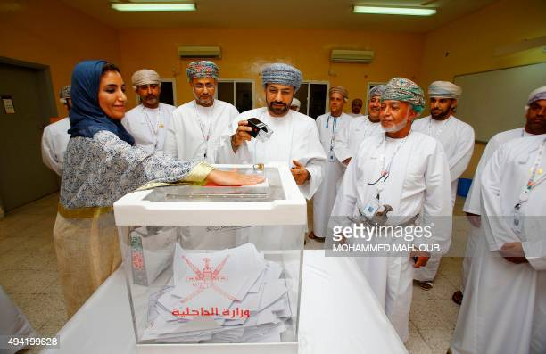 Omani Interior Minister Hamoud bin Faisal Al Busaidi seals a ballot box at a polling station in Muscat for a consultative council elections on...
