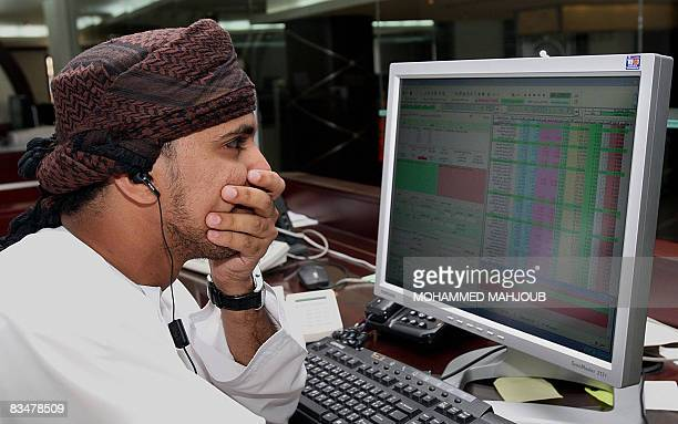 A Omani investor follows share values at the stock exchange in the Omani capital Muscat on October 9 2008 Most Arab stock markets rebounded today...