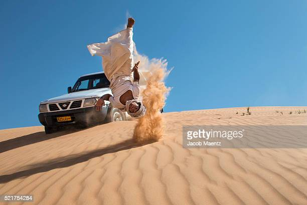 Omani jumping in desert