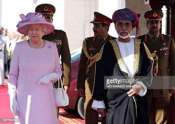 Omani leader Sultan Qaboos bin Said welcomes Queen Elizabeth ll at an official welcoming ceremony on November 26 in Muscat, the second leg of the...