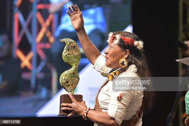 Omani Manuela a huaoranis native receives the award Latinoamerica verde at the Crystal Palace in Guayaquil Ecuador on September 25 2015 Wao a project...