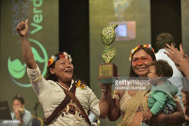 Omani Manuela and Patricia Nenquihui huaoranis natives receive the award Latinoamerica verde at the Crystal Palace in Guayaquil Ecuador on September...