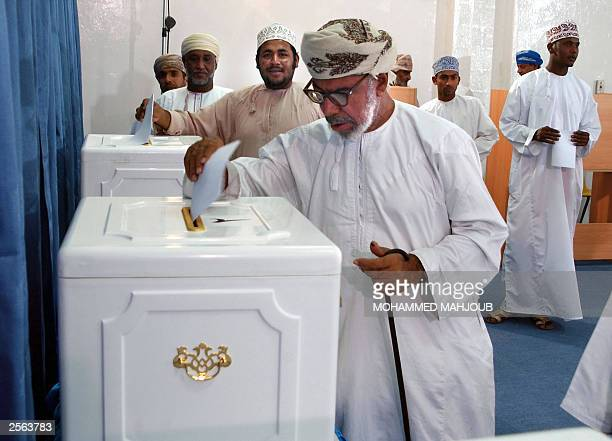Omani men cast their votes at a polling station in Muscat 04 October 2003 Omanis were going to the polls to choose an 83member advisory council in...