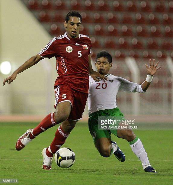 Omani player Mohammed Abdullah vies with Indonesia's Bambang Pamungkas during their 2011 Asian Cup qualifying football match in Muscat on January 19...