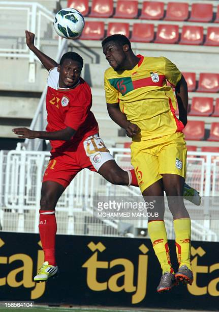 Omani player Mohammed Hamad fights for the ball with Badirou Abiola of Benin during their friendly match in Sur 150 kms southeast of the capital...