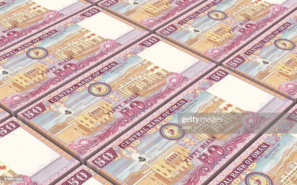 Omani rials bills stacked background. : Stock Photo