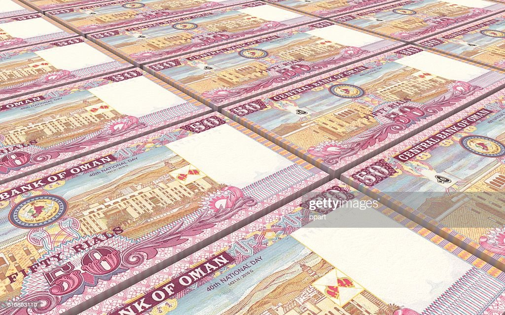 Omani rials bills stacked background. : Stock Photo