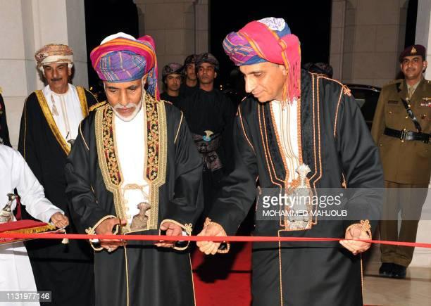 Omani ruler Sultan Qaboos bin Said and Deputy Prime Minister Fahd bin Mahmud al-Said cut the ribbon during the inauguration ceremony of the Royal...