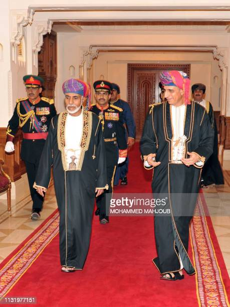 Omani ruler Sultan Qaboos bin Said walks with Deputy Prime Minister Fahd bin Mahmud al-Said during the inauguration ceremony of the Royal Opera House...