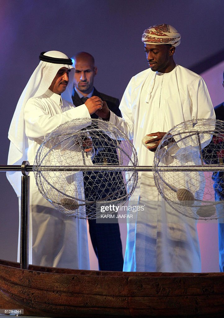 Omani soccer star Hani al-Dhabet (R) and : News Photo