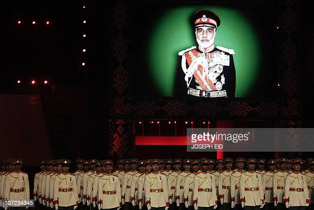 Omani soldiers parade under a picture of Omani ruler Sultan Qaboos bin Said on the third day of celebrations marking 40 years since he took the...
