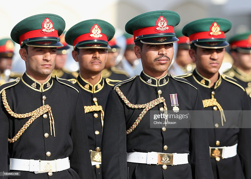 Omani soldiers prepare for the arrival of Prince Charles, Prince of Wales and Camilla, Duchess of Conrnwall at the VIP section of Muscat International airport on the seventh day of a tour of the Middle East on March 17, 2013 in Muscat, Oman. The Royal couple are on the fourth and final leg of a tour of the Middle East taking in Jordan, Qatar, Saudia Arabia and Oman.