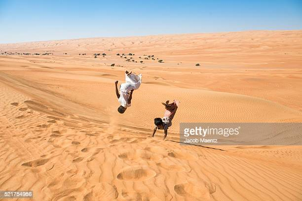 Omani youth jumping in desert