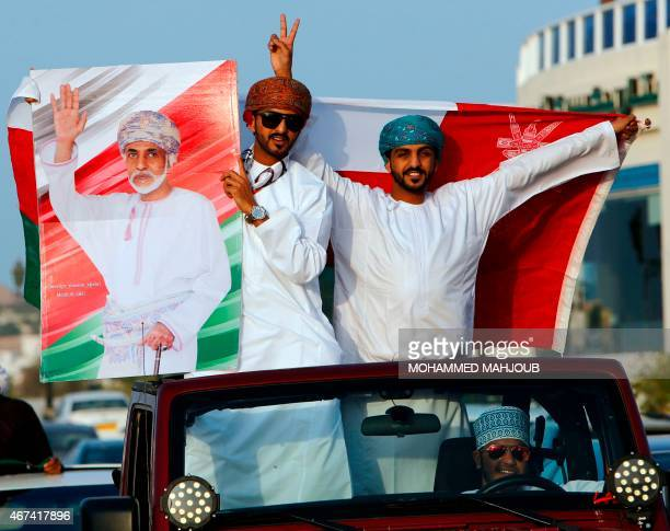 Omanis hold a placard bearing a portrait of their leader Sultan Qaboos bin Said who flew home the previous day after he spent more than eight months...