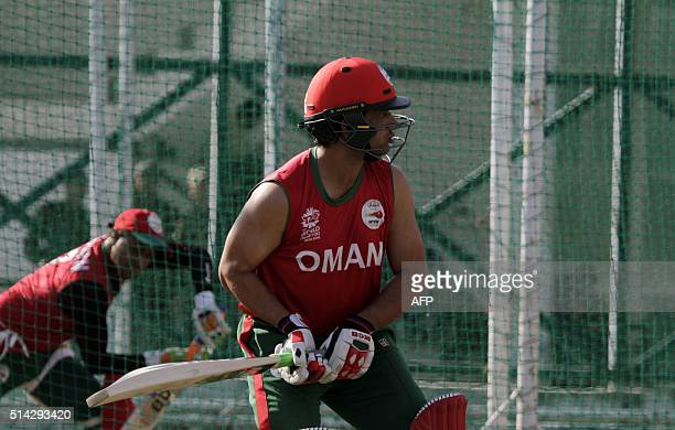 Oman's Adnan Ilyas takes part in a net practice session ahead of the World T20 cricket tournament at The Himachal Pradesh Cricket Association Stadium...