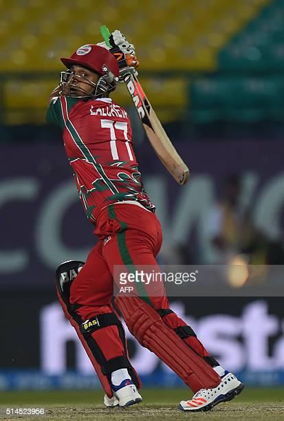 Oman's Ajay Lalcheta plays a shot during the World T20 cricket tournament match between Ireland and Oman at The Himachal Pradesh Cricket Association...