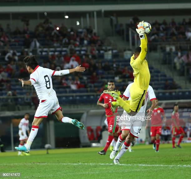 Oman's Faiz alRushaidi catches the ball after Bahrain's Ibrahim Ahmed Habib attempted a shot on goal during the 2017 Gulf Cup of Nations semifinal...