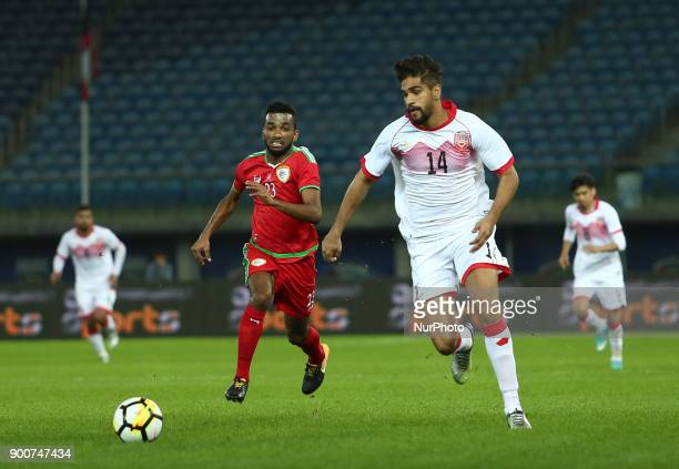 Oman's Harib al-Saadi fights for the ball against Bahrain's Ibrahim Ahmed Habib during the 2017 Gulf Cup of Nations semi-final football match between...