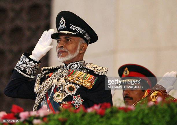 Oman's leader Sultan Qaboos bin Said salutes on the third day of celebrations marking 40 years since he took the throne at Midan al-Fath Stadium in...