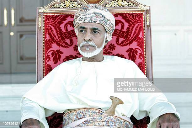Oman's leader Sultan Qaboos bin Said sit along side Britain's' Queen Elizabeth II as they attend an equestrian show at Madinat alHidayat on November...