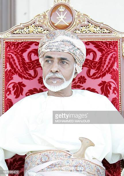 Oman's leader Sultan Qaboos bin Said sits along side Britain's' Queen Elizabeth II as they attend an equestrian show at Madinat alHidayat on November...