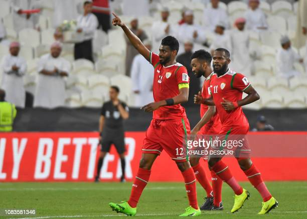 Oman's midfielder Ahmed Al Mahaijri gestures after scoring during the 2019 AFC Asian Cup group F football match between Oman and Turkmenistan at the...