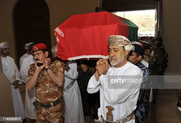 Oman's newly sworn-in Sultan Haitham bin Tariq and General Sultan bin Mohammed al Nomani carry the coffin of the late leader Sultan Qaboos to the...