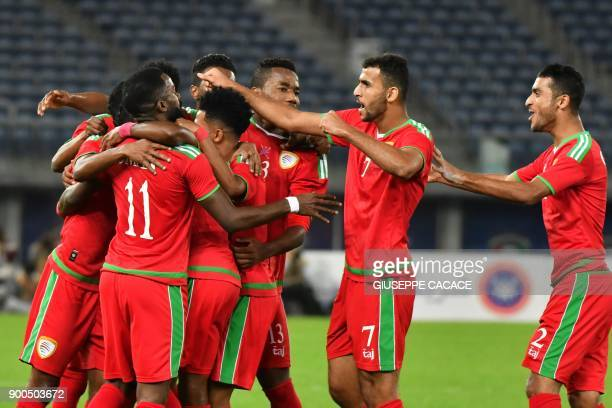 Oman's players celebrate after scoring a goal during the 2017 Gulf Cup of Nations semifinal football match between Oman and Bahrain at the Sheikh...