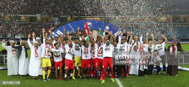 Oman's players celebrate after winning the Gulf Cup of Nations 2017 final football match between Oman and the UAE at the Sheikh Jaber alAhmad Stadium...