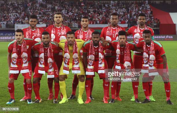 Oman's players pose for a picture prior to their Gulf Cup of Nations 2017 final football match against the UAE at the Sheikh Jaber alAhmad Stadium in...