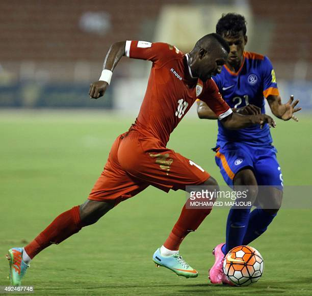 Oman's Saad alMukhaini fights for the ball against India's Narayan Das during the AFC qualifying football match for the 2018 FIFA World Cup between...